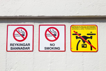 A no smoking or drone sign