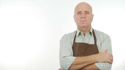 Confident Image with a Man Wearing Apron Keeping Arms Crossed