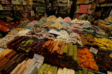 A shop owner selling traditional candies waits for customers in Istanbul