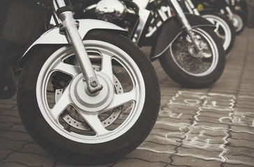 A sports bike is standing on the ground close up