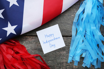 American flag and paper with inscription Happy Independence Day