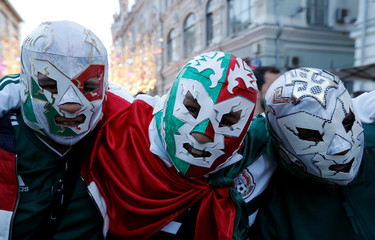 Supporters of the Mexican national soccer team pose during a gathering on the first day of the 2018 FIFA World Cup in central Moscow