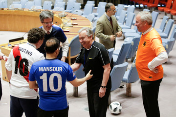 Members of the United Nations Security Council shake hands with U.N. Secretary General Antonio Guterres before posing for a picture while wearing soccer jerseys to commemorate the inauguration of the Wold Cup at the U.N. headquarters in New York City