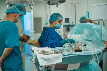doctors working in the operating room