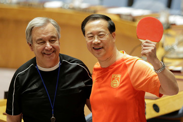 U.N. Secretary-General Antonio Guterres and China's ambassador to the U.N. Ma Zhaoxu pose wearing soccer jerseys to commemorate the inauguration of the Wold Cup at the United Nations headquarters in New York City