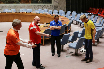 Members of the United Nations Security Council play soccer inside the chamber before posing for a picture while wearing soccer jerseys to commemorate the inauguration of the Wold Cup at the United Nations headquarters in New York City