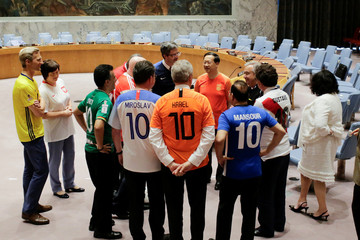 Members of the United Nations Security Council gather together before posing for a picture while wearing soccer jerseys to commemorate the inauguration of the World Cup, at the United Nations headquarters in New York City