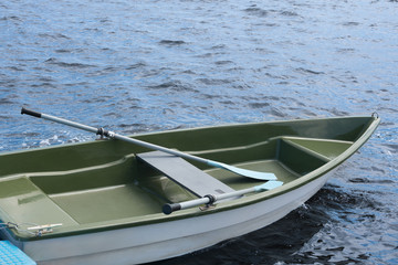 Plastic boat on water, close-up.