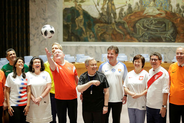 Members of the United Nations Security Council pose for a picture while wearing soccer jerseys to commemorate the inauguration of the World Cup, at the United Nations headquarters in New York City