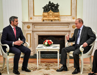Russian President Putin speaks with Paraguayan President-elect Abdo during their meeting in Moscow