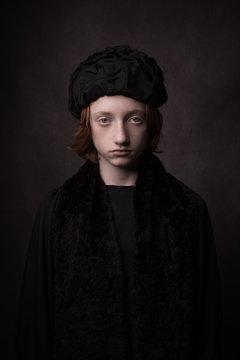 Painterly studio portrait of renaissance classic boy wearing black cap