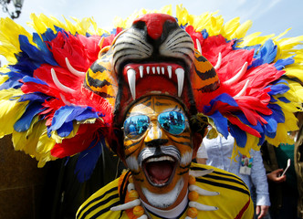 A supporter of the Colombian national soccer team cheers during a gathering on the first day of the 2018 FIFA World Cup in central Moscow