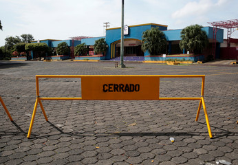 "A signal that reads "" Closed"" is seen at the entrance of a Mall during National strike in Managua"