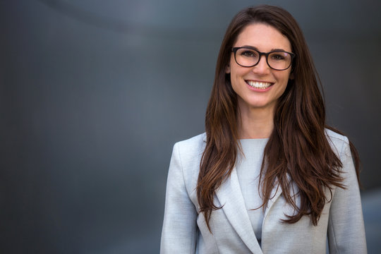 Warm likable commercial friendly portrait of a smart beautiful natural woman, business executive person