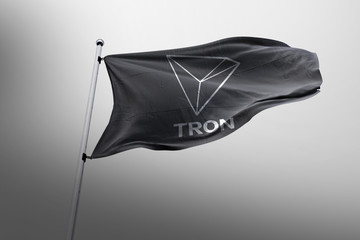 TRON cryptocurrency icon on realistic flag 3d render.