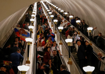 Soccers fans are seen at the escalator at a subway station on the first day of the 2018 FIFA World Cup in Moscow