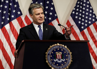FBI Director Wray takes question during a news conference on the inspector general's report at FBI headquarters in Washington