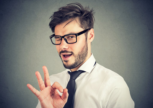Ironic man showing OK gesture