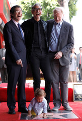 Actor Goldblum poses on his star with Eisen and Begley Jr. as his son River crawls after it was unveiled on the Hollywood Walk of Fame in Los Angeles