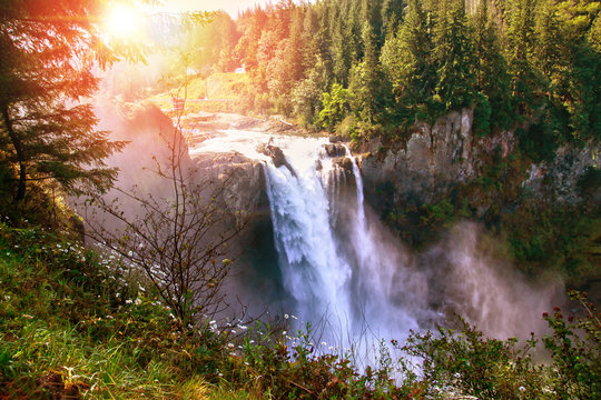Morning Sunrise Over Snoqualmie Falls in Washington State. The waterfall is sacred to the Snoqualmie native Indians who have lived for centuries in the Snoqualmie Valley.