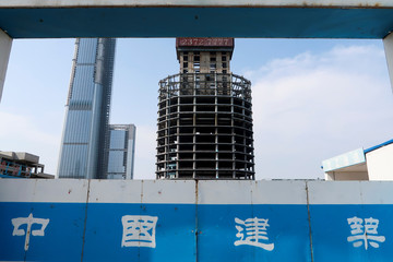 A construction site fence surrounds the site of the Goldin Finance 117 skyscraper in Tianjin's high-tech zone