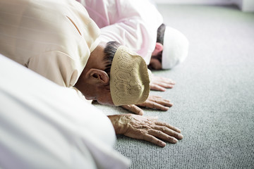 Muslim people praying in Sujud posture