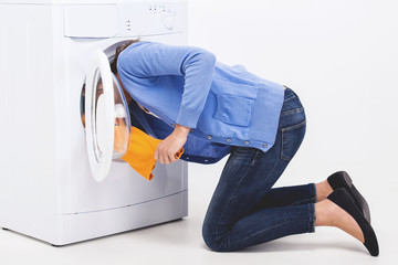 Woman shoved her head into washing machine.