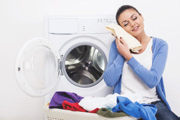 Woman with clothes in hands after washing.