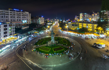 Da Lat, Vietnam - May 12th, 2017: Da Lat Market night skyline night view with lights attracts thousands of people walking along the road shopping crowded bustle of city tourism in Da Lat, Vietnam