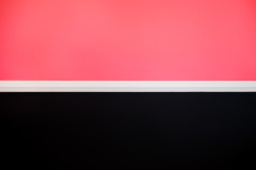 Pink and black wall background texture modern interior design with copy space for text or image. Famingo concept.