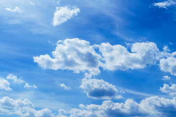 Blue, fluffy clouds in the sky. Background of nature, stratosphere.