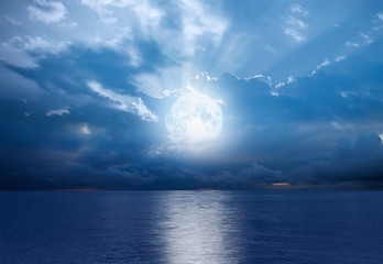 """Night sky with full moon and reflection in sea,  """"Elements of this image furnished by NASA"""""""