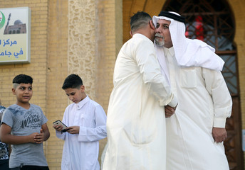 Sunni worshippers exchange greetings after Eid al-Fitr prayers to mark the end of the fasting month of Ramadan at a Sunni mosque in Baghdad