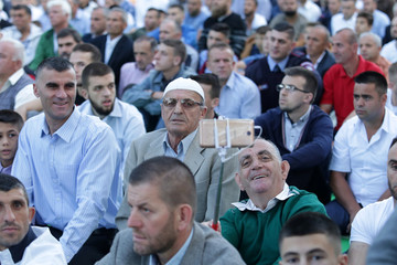Albanian Muslims take a selfie before morning prayers during the first day celebration of Eid al Fitr in Tirana