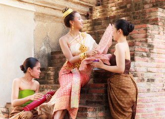 Asian noble beauty with maids dressed in traditional clothes shopping in old retro historical period theme