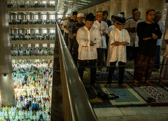 Muslims perform prayers for  Eid al-Fitr  at Istiqlal Mosque, Jakarta,