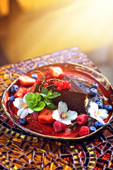 chocolate cake decorated with fruits