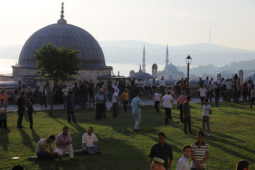 Worshippers wait for praying time during the first day celebration of Eid al Fitr at Suleymaniye Mosque in Istanbul