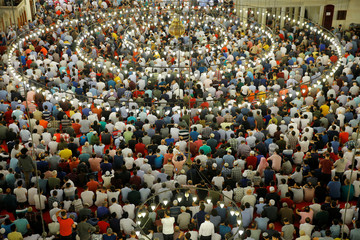 Worshippers pray during the first day celebration of Eid al Fitr at Suleymaniye Mosque in Istanbul
