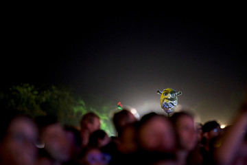 Revellers dance with an illuminated Shrek sign as Chromeo perform during the Firefly Music Festival in Dover
