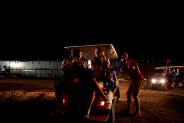 VIP ticket holder revellers are transported by golf cart during the Firefly Music Festival in Dover