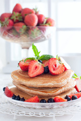 Summer breakfast with homemade punkakes of wholemeal flour and strawberries, selective focus