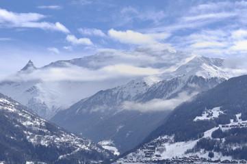 peak mountain under clouds