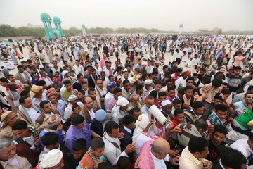 Worshippers gather to perform Eid al-Fitr prayers marking the end of the holy fasting month of Ramadan in the Red Sea Port city of Hodeidah