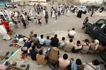 Worshippers perform Eid al-Fitr prayers marking the end of the holy fasting month of Ramadan in the Red Sea Port city of Hodeidah