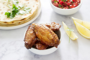 Homemade delicious food of tortillas, salsa and fried wings.