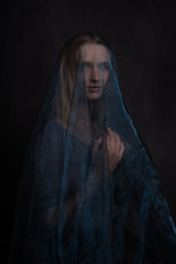 Studio portrait of woman wearing veil