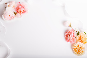 Festive flowers English rose composition on the white background. Overhead top view, flat lay. Copy space. Birthday, Mother's, Valentines, Women's, Wedding Day concept