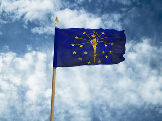Indiana flag USA flag Silk waving flag made transparent fabric of Indiana US state with wooden flagpole gold spear on background sunny blue sky white smoke clouds real retro photo 3d illustration