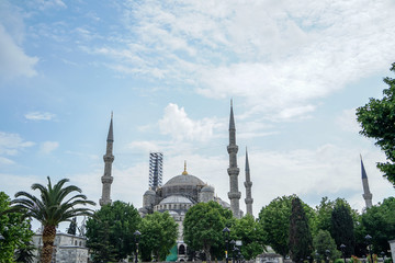 The blue mosque architectural landscape view showing heritage building restoration on blue sky background, Istanbul